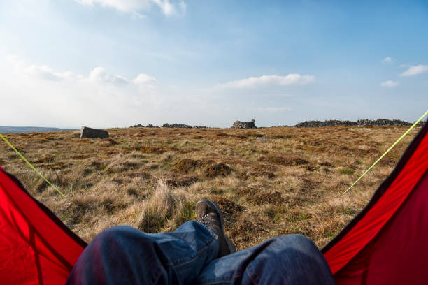 pov from inside a red tent, wild camping. - tent stock photos and pictures