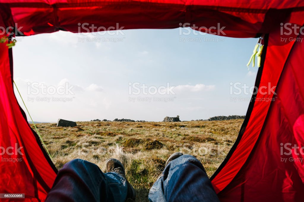 POV from inside a red tent, wild camping. stock photo