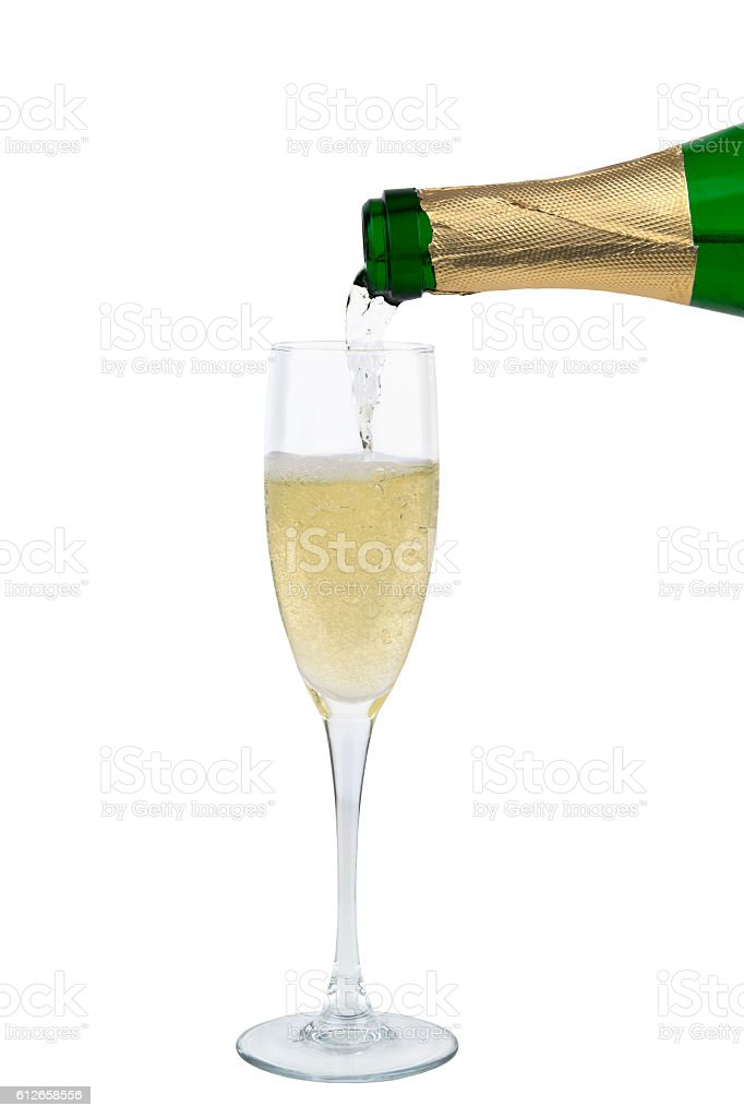 from the bottle is poured into a glass of champagne stock photo