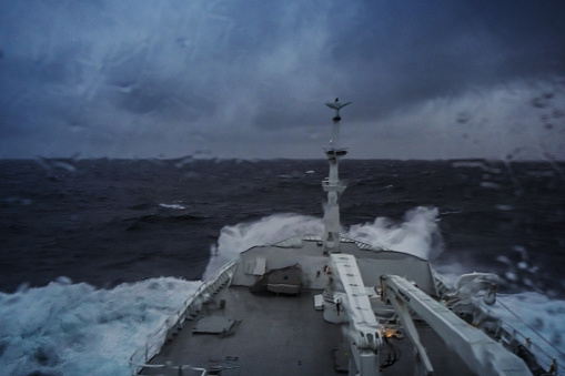 POV From the bridge of a boat sailing angry and rough ocean