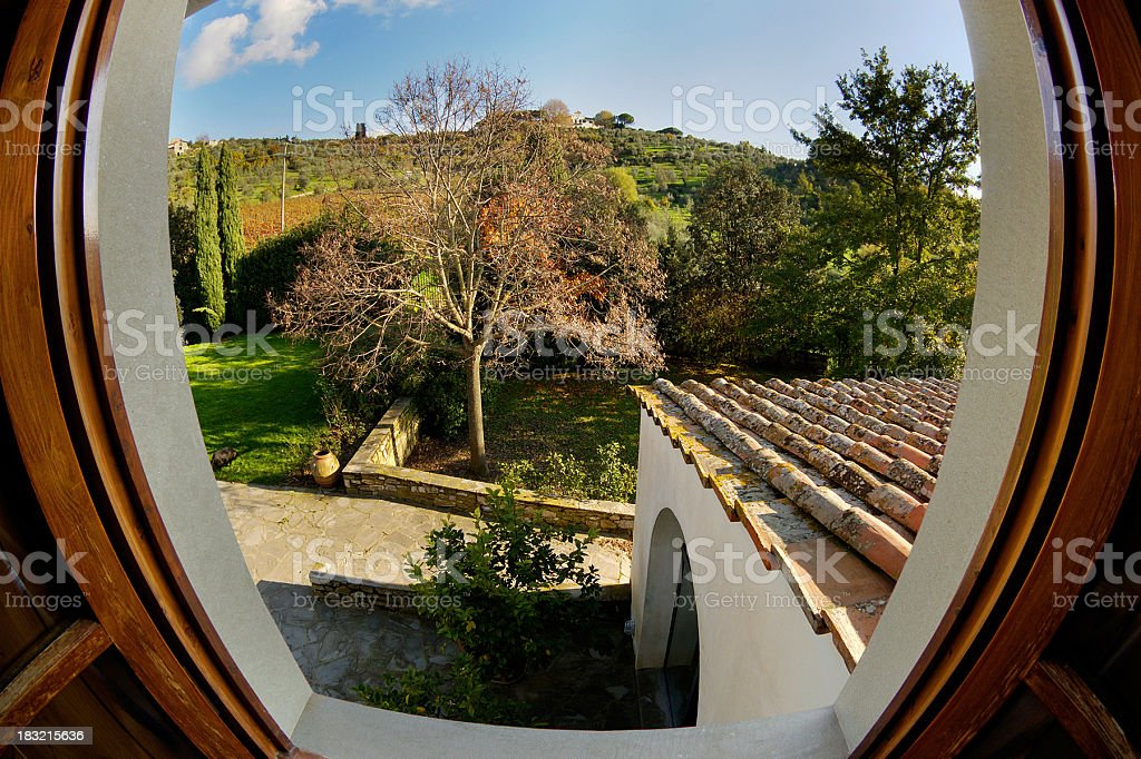 From the window: country house's garden and the Tuscan hills stock photo