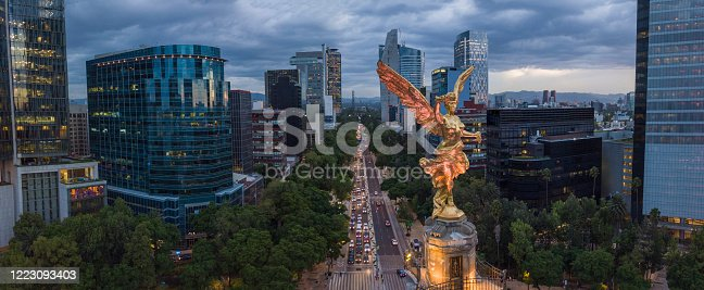 istock Front aerial view of the statue of the angel of independence on Reforma Avenue with chapultepec forest in the background 1223093403