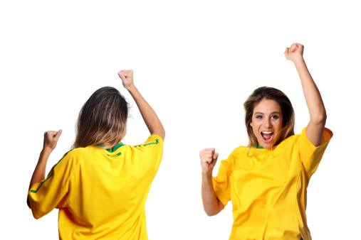 Image from Brazilian iStockalypse (MIS) Sao Paulo - A Brazilian fan wearing a Brazilian soccer team t-shirt, cheering for its team - Front and back view.