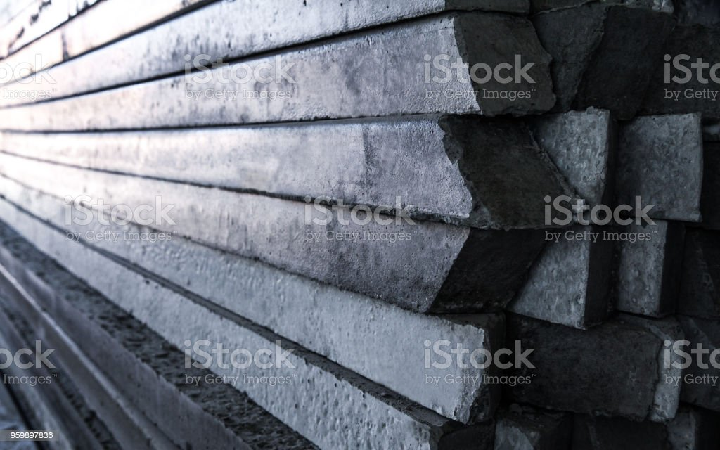 Front And Side View Of Concrete Pole Pile Stock Photo
