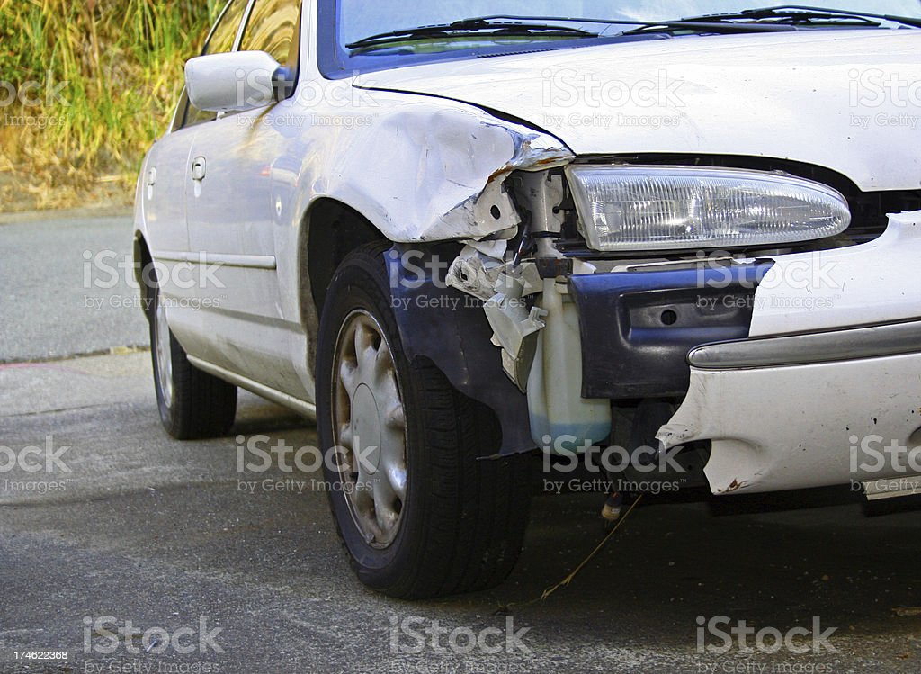 AUTOMOBILE CRASH Front Bumper Damage on White Car royalty-free stock photo