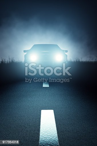 istock Front Car lights at night on open road 917354018