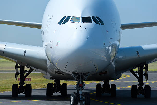 Front Close-up of a Large Commercial Jet Airplane stock photo