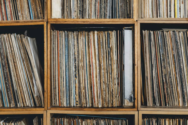 Front close-up of shelf with vinyl records stock photo