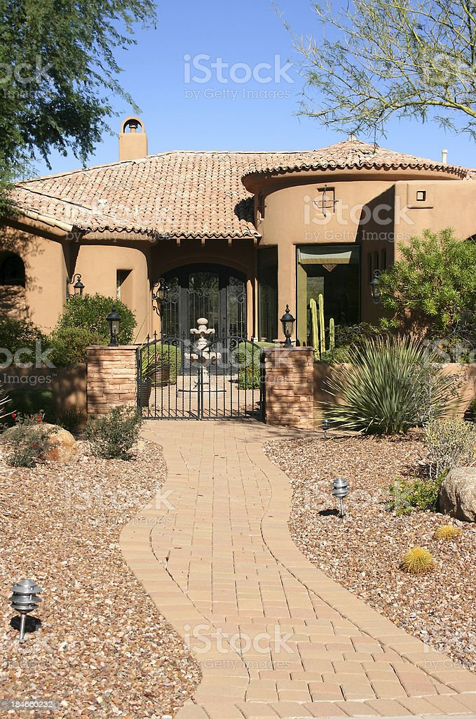 Front Courtyard of an Upscale Southwestern Home stock photo
