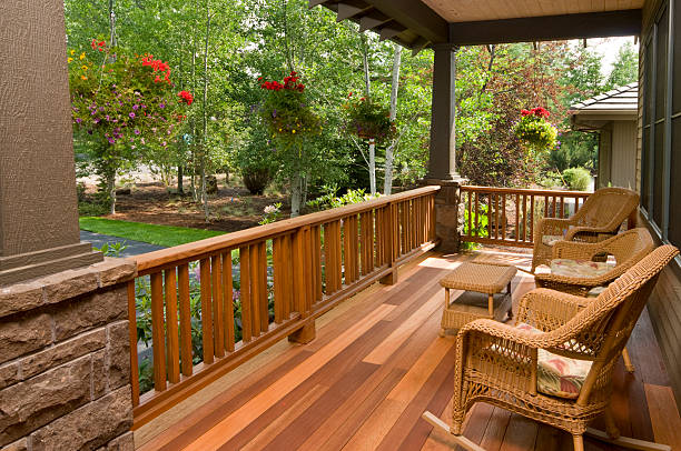 Front deck with wicker chairs stock photo