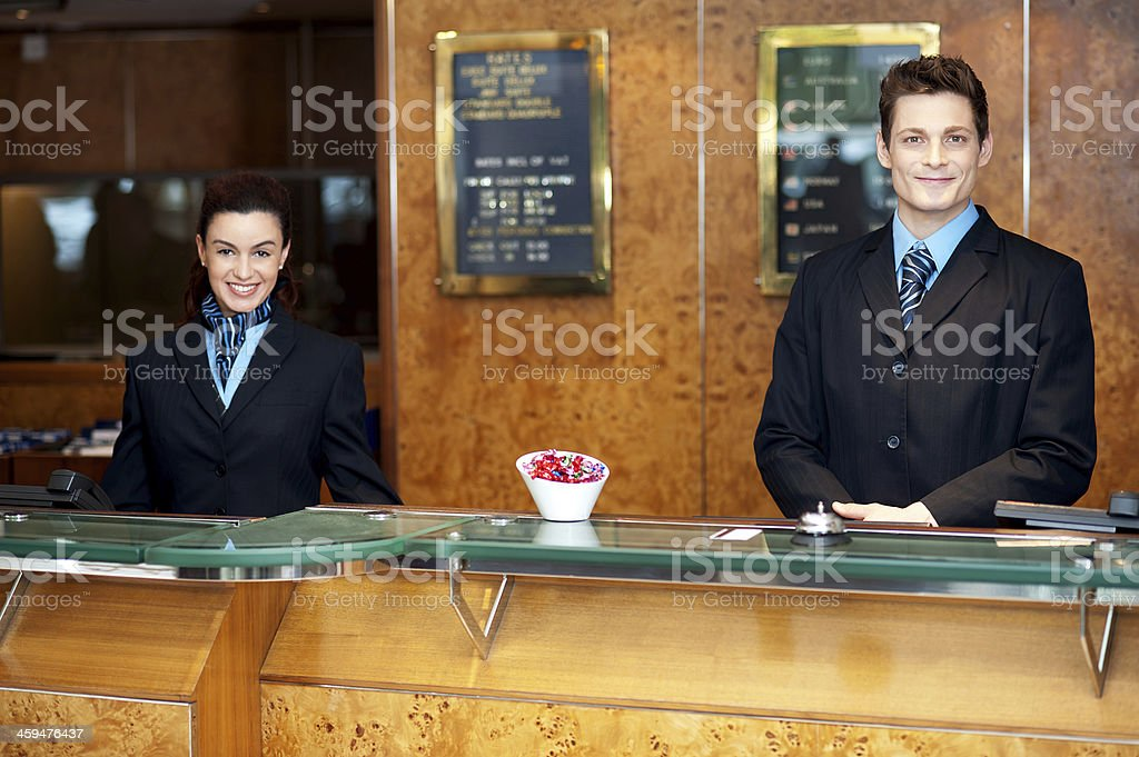 Front desk colleagues posing for a picture stock photo