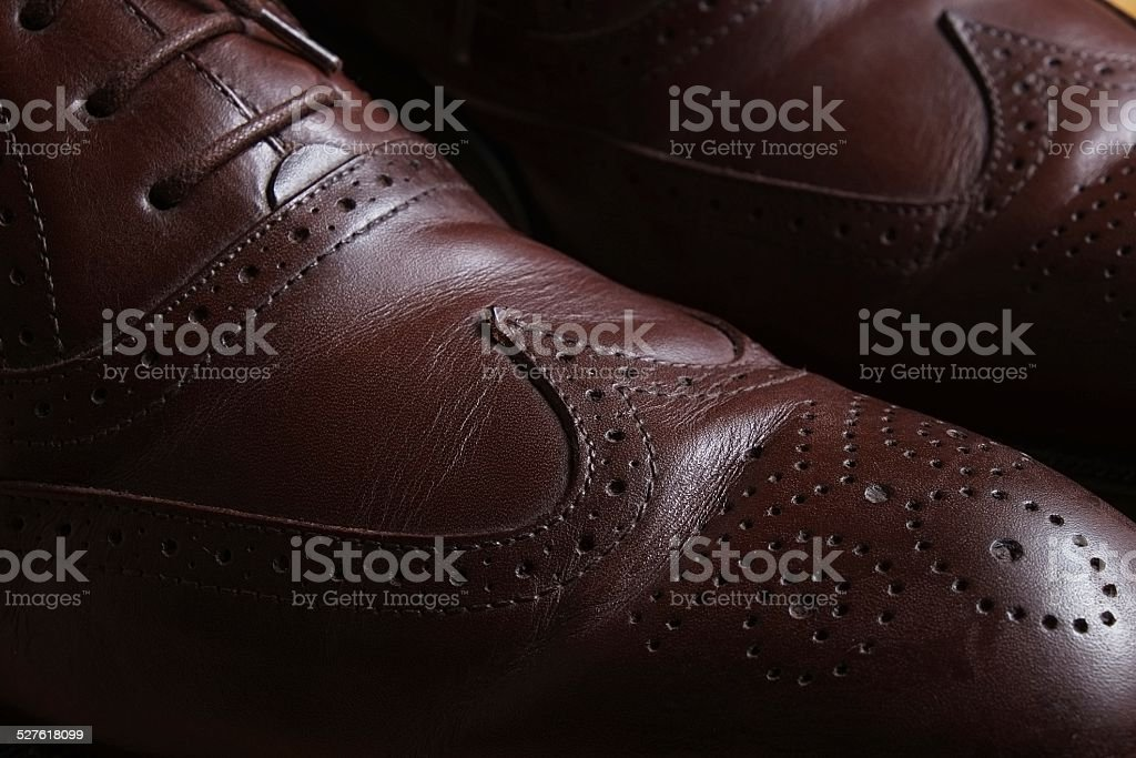 Front detail of a pair of brown leather classic Brogue shoes stock photo
