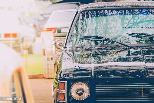 Front detail with headlight and classic black car lights. Vintage style. Selective focus.