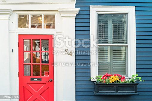 Front door and windows of a traditional wooden, clapboard house in the historic Charlestown, the oldest neighborhood in Boston, Massachusetts, USA.