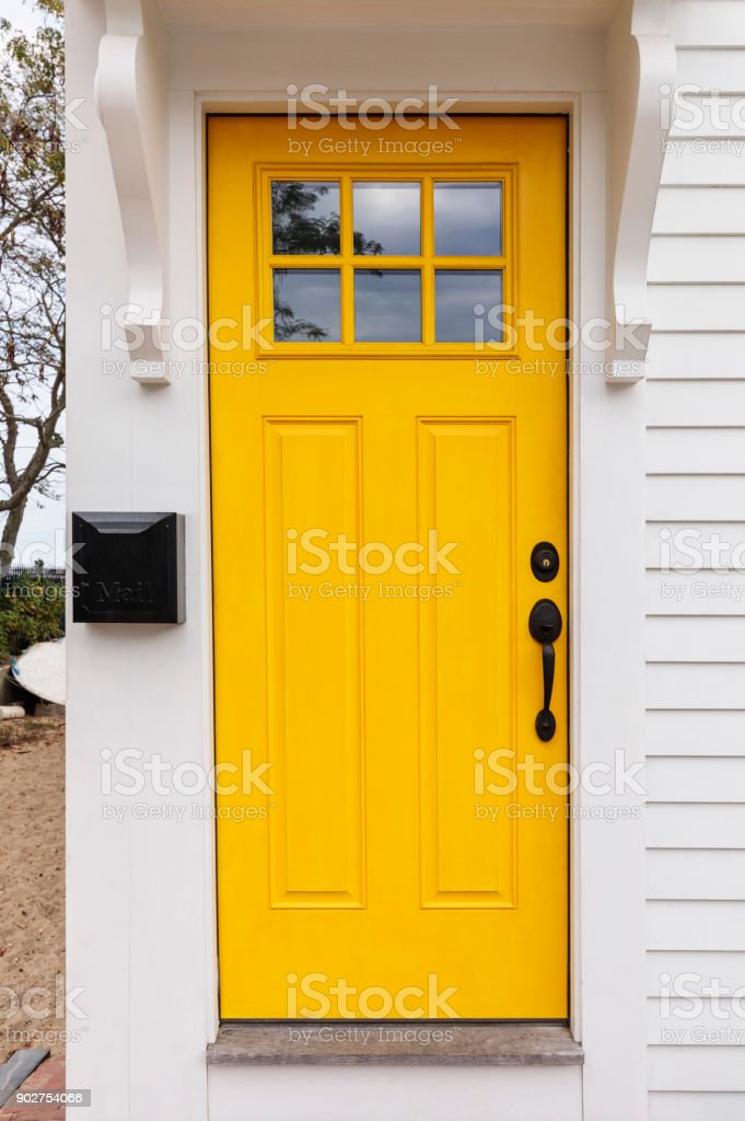 Front door, bright yellow front door stock photo
