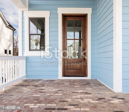 front door of a house that is painted blue and the door is made of wood