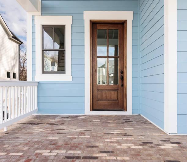 Front door, brown front door with light blue exterior front door of a house that is painted blue and the door is made of wood front door stock pictures, royalty-free photos & images