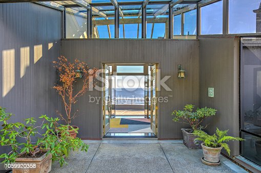 Front door entry to house: Modern, luxurious skylight home by ocean in northern California
