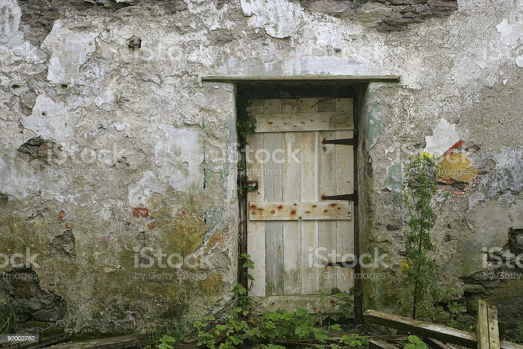 Front door from abandoned house royalty-free stock photo