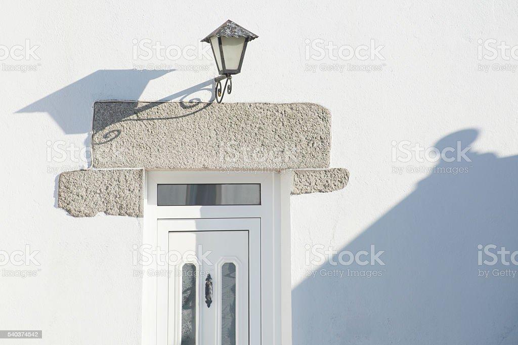 Front door in the sunlight, stone lintel. stock photo
