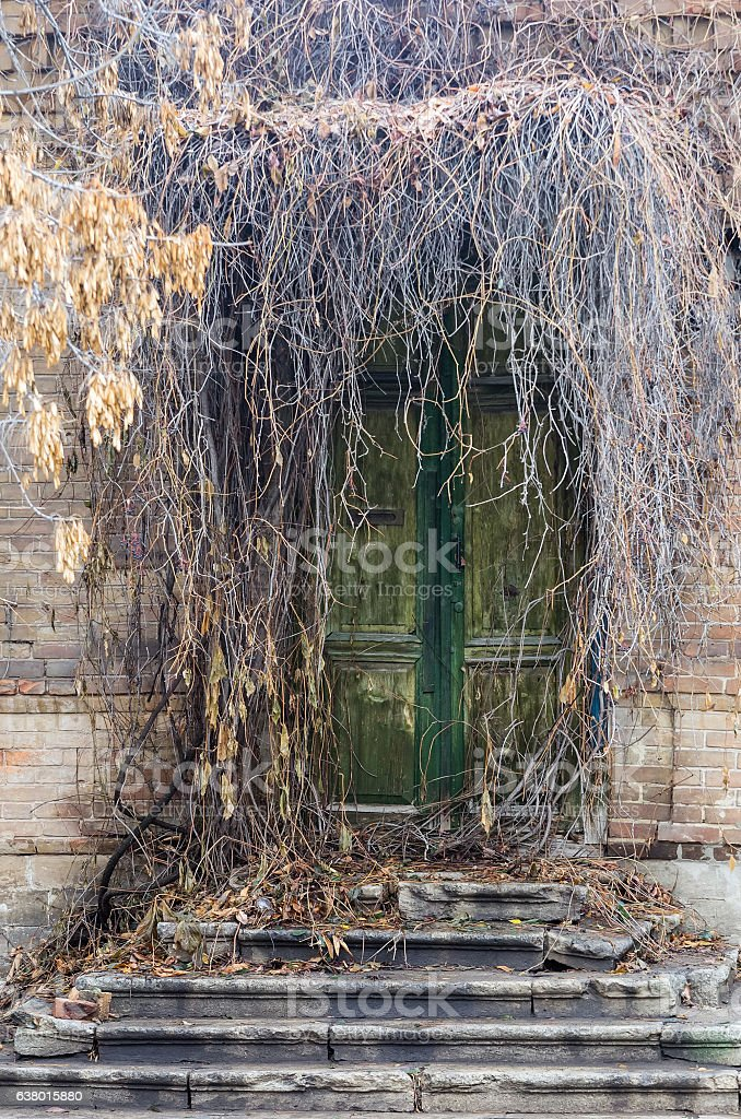 Front door of an old abandoned house stock photo