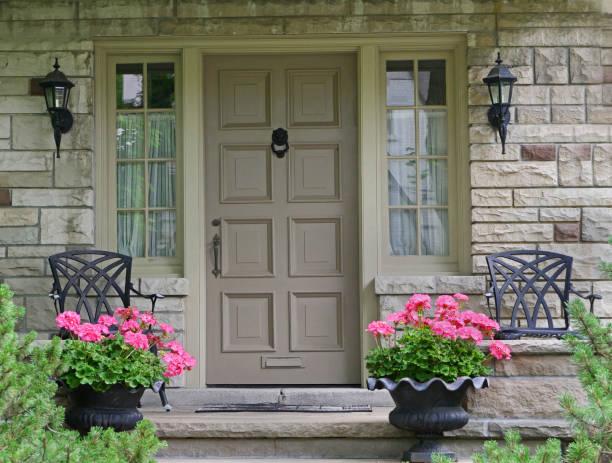 front door of house with flower pot front door of house with flower pot front door stock pictures, royalty-free photos & images