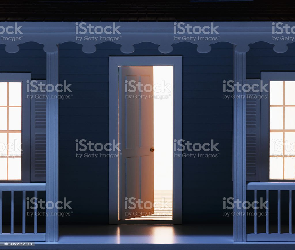 Front door of model house illuminated, close-up royalty-free stock photo