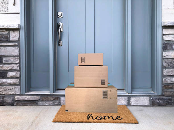 Front Door Packages packages at front door package stock pictures, royalty-free photos & images