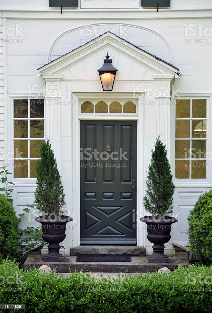 Front door to luxury home With garden landscape stock photo