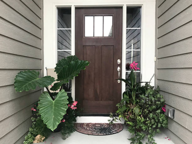 front door tropical pink and green plants - hawaii home stock photos and pictures