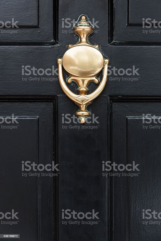 front door with a door knocker stock photo