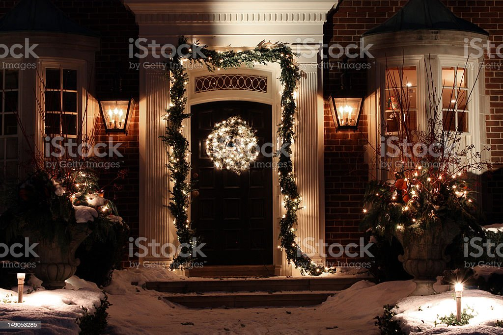 Front door with Christmas decorations stock photo