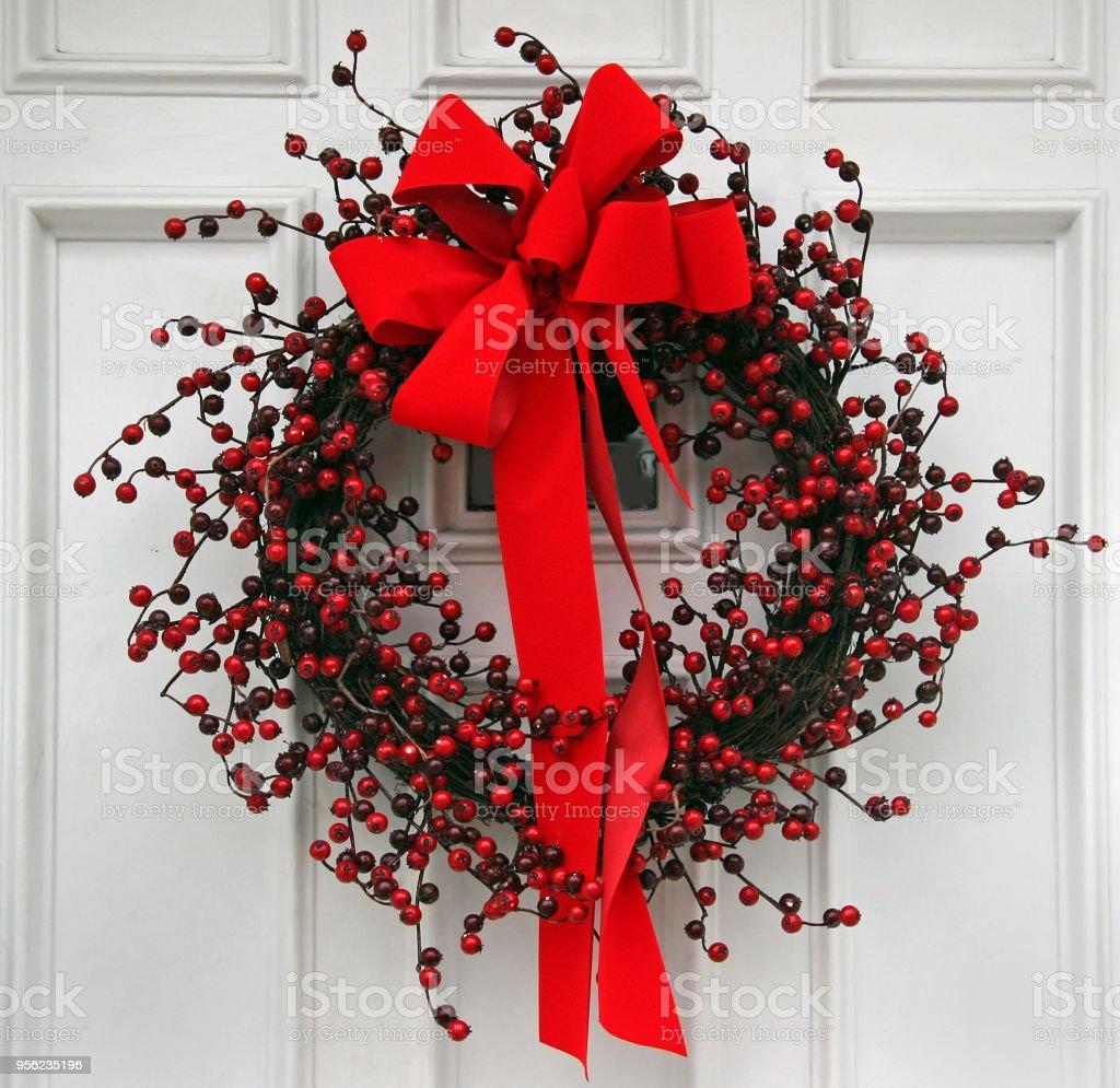 front door with Christmas wreath stock photo