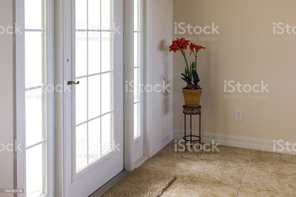 front door with daylight shining through royalty-free stock photo