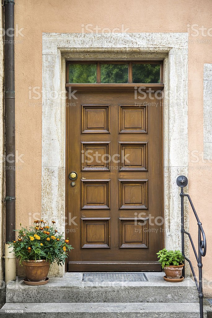 Front door with decorative flowers royalty-free stock photo