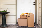 istock Front Door with Delivery Boxes 1248789819
