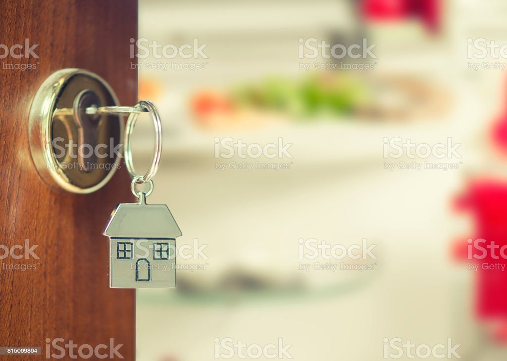 Front door with house keys stock photo