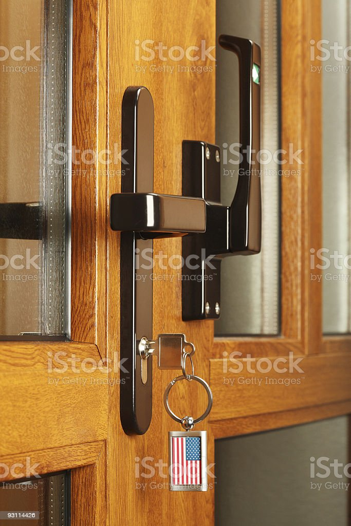 Front door with key. royalty-free stock photo