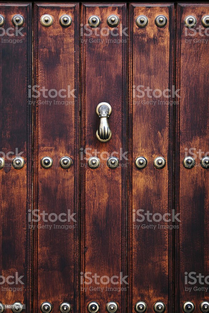 Front door with knocker royalty-free stock photo