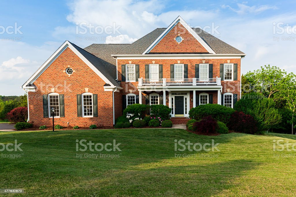 Front elevation large single family home stock photo
