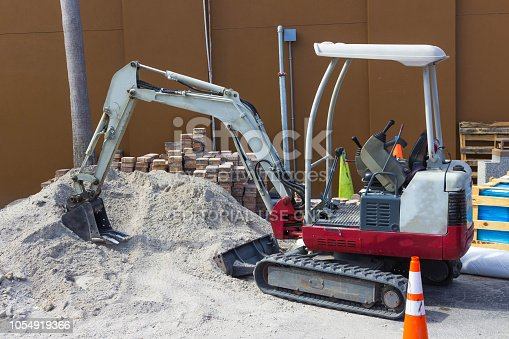 Cocoa beach, USA - April 29, 2018:Front end loader dumping stone and sand at at constraction site