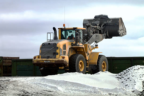 Front End Loader Entraining Freight Car stock photo