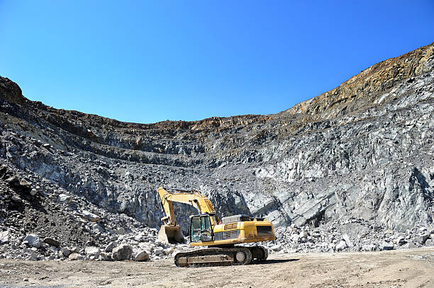 Front end loader in open pit mine stock photo