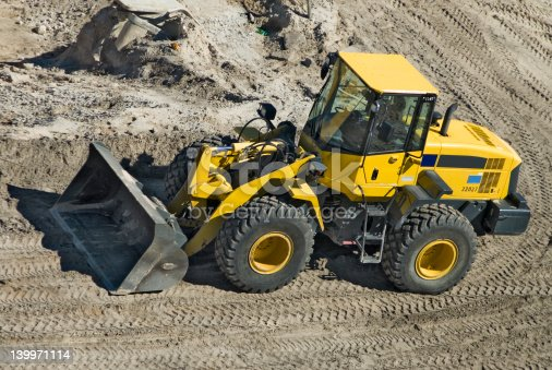 A new front end loader is ready to move some dirt at a South Florida construction site. Almost looks like a Tonka Toy!