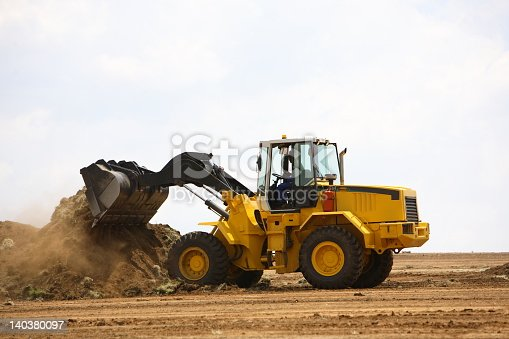 Front end loader clearing a construction site