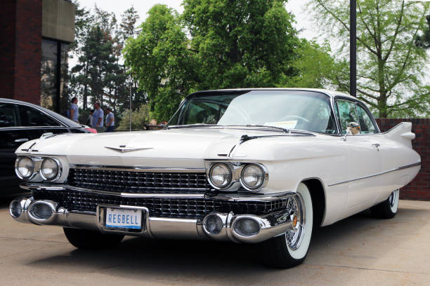 Front end of a 1959 Cadillac Sedan de Ville Flint, Michigan 30, 2017:  1959 Cadillac Coupe de Ville.  This model represents the high point of American car design and luxury. ville stock pictures, royalty-free photos & images
