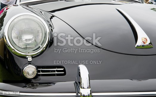 Dana Point, CA, USA - July 21, 2013: A close-up of the front hood, headlight, turn signal, intake vents, bumper, and badge on a vintage, Black Porsche 356B, at the Annual 356 Club of Southern California Dana Point Concours, which took place at Lantern Bay Park.