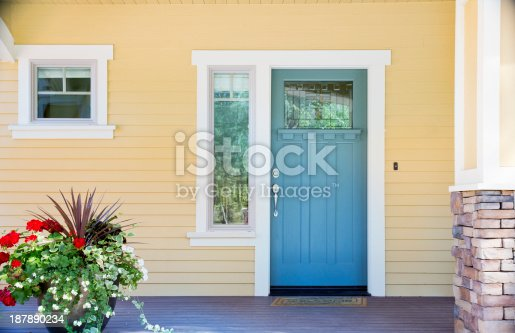 istock Front entrance of a home with blue door 187890234