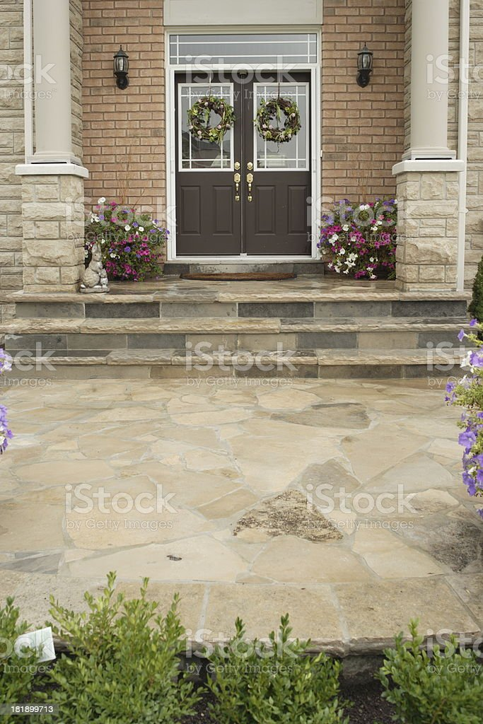 Front Entrance of Luxury Private residence featuring slated stone path