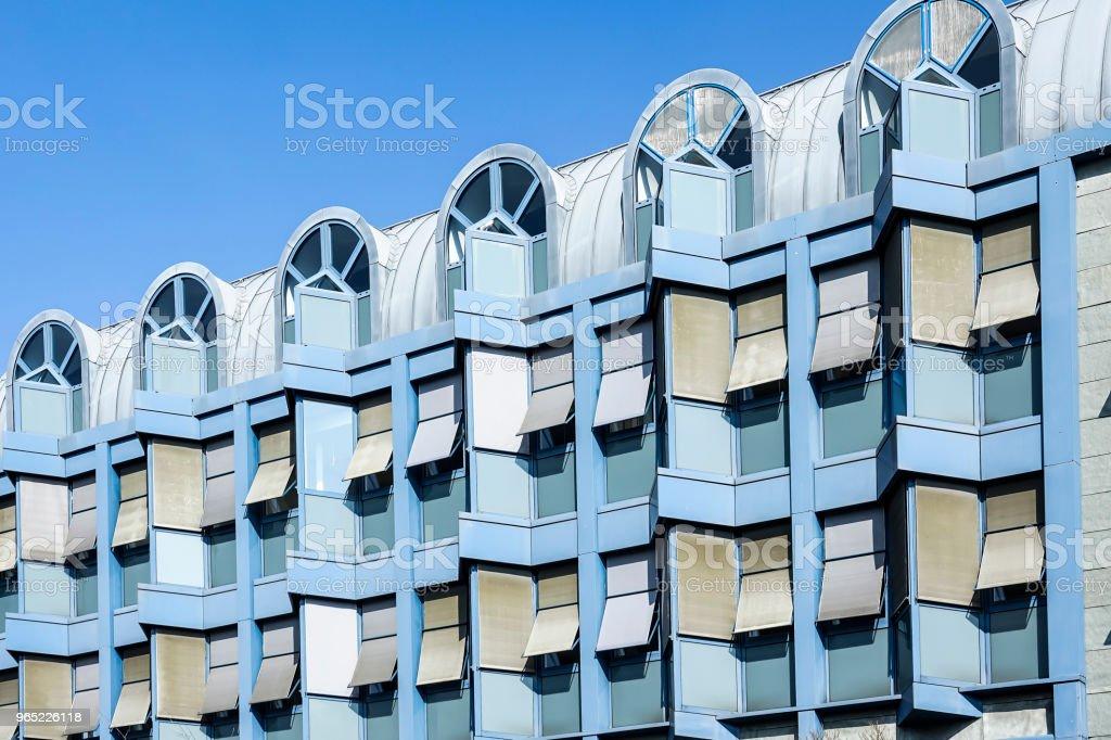 Front facade of a contemporary blue office building zbiór zdjęć royalty-free